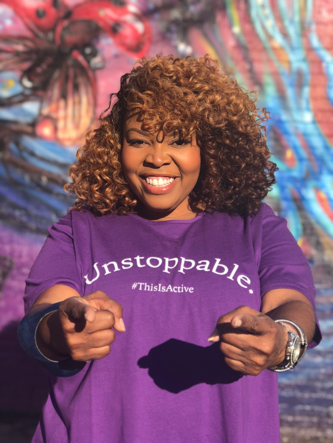Photo of a woman wearing a JunoActive plus-size tee for the Plus Strut